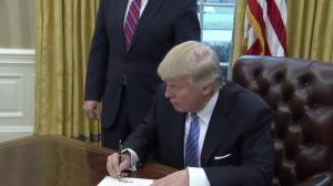 President Trump signs executive order to withdraw U.S. from TPP