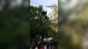 Caught on camera: Crowd catches teen falling from Six Flags gondola ride