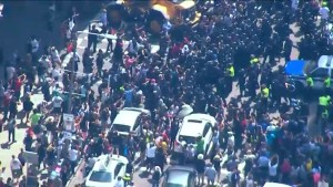 Protester clash with police in the streets of Boston