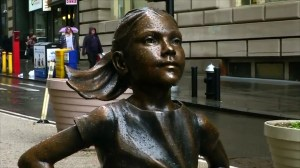 'Fearless Girl' statue stares down Wall Street bull to mark International Women's Day