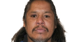 Lethbridge police hunt for man charged with murder