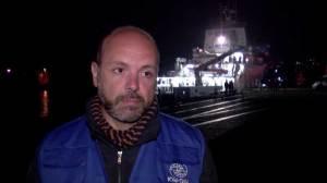 Italians greet 28 survivors of capsized migrant boat