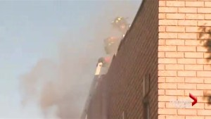 Toronto firefighter in hospital after being pulled from burning building