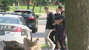 Police walk Aaron Driver to car after he was re-arrested on Friday afternoon in Winnipeg
