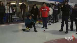 Refugees learn to curl, handle icy wipeouts at Toronto rink