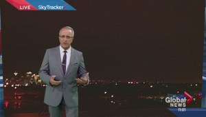 Lightning illuminates Paul Dunphy's weather forecast