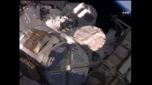 Spacewalk installs new docking hatch on ISS