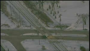 Global's SkyView 1 hovers over the location of an overnight crash involving a train and pedestrian