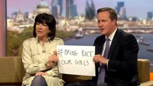 "British PM holds up sign ""bring back our girls"" demands Nigerian schoolgirls are released"