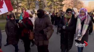 Community stages solidarity march after Muslim woman attacked