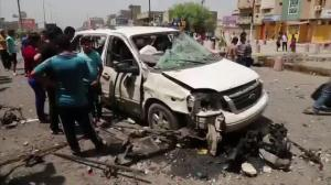 Raw video: Aftermath of car bombing on commercial street in Baghdad