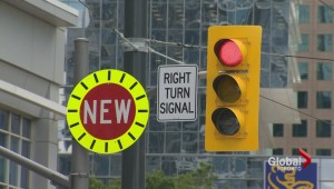 Confusing signage leading to vehicles turning into streetcar lanes on Queen's Quay