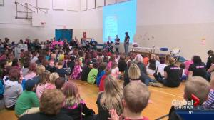 Local school rallies behind teacher, one step at a time