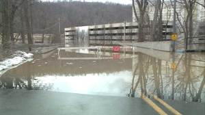 Ohio River floods Louisville forcing road and business closures