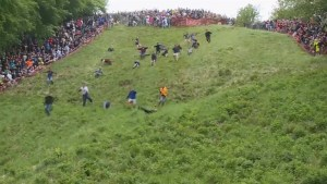 Hundreds chase runaway cheese wheel down steep hill in the UK