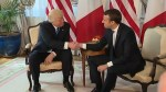 'Death grip' handshake shared by Trump and France's Macron comes under scrutiny