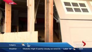 Car crashes into Auburn Bay house