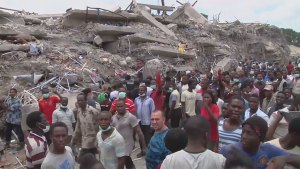 Rescuers continue to search through rubble after building collapse in Lagos