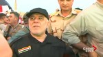 Iraqi PM greeted by cheering crowds as he tours Mosul