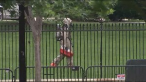 White House placed on lockdown after woman throws metal object over fence