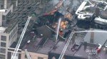Aerial view of firefighters battling hotspots after massive Toronto athletic club fire