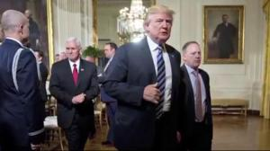 White House shakeup as Trump digs in on Russia