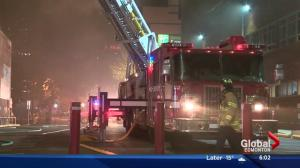 Edmonton firefighters battle fire at downtown building