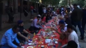 London's Muslim community holds Iftar meal on the street following apartment fire