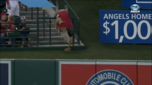 Dad nearly dumps himself and his daughter over railing trying to snag foul ball