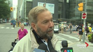 Mulcair has choice words for Harper, Trudeau at Toronto's Labour Day Parade