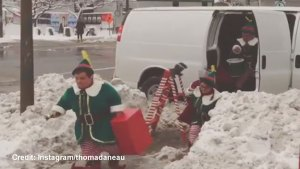 Elves decorate a Montreal bus stop