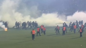 Greek soccer fans clash with police in riot