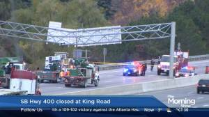 Dump truck damages HWY 400 sign, southbound closed between King and Teston