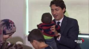 Justin Trudeau and his wife Sophie speak with parents, children at Immigrant Services society of Vancouver