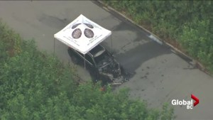 Aerial view of burned out SUV along 24th Ave in Surrey