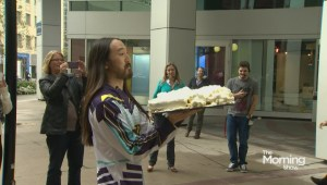 DJ Steve Aoki cakes a couple fans on live TV