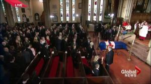 Rob Ford's wife Renata prays as casket arrives inside St. James Cathedral