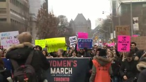 Thousands of people march for Women's March Toronto