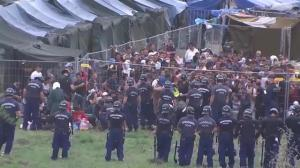 Refugees make their escape from camp in Hungary
