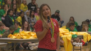 Olympic medalist Ashley Steacy surprises students at her former high school