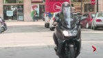Free parking, lower costs lure motorcyclists