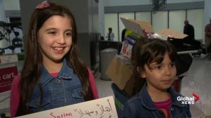 Canadian kids show off their signs welcoming Syrian refugees