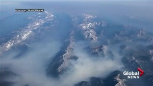 Mystic smoke from wildfires drifts through Rocky Mountains