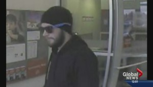 Police hunt for armed robber across western Canada