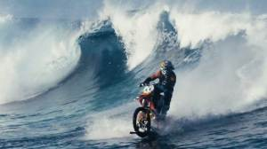 Robbie Maddison surfs waves on a dirt bike in epic stunt