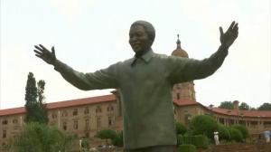 Miniature sculpted bunny on Nelson Mandela statue causes stir