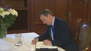 British PM signs book of condolence after Mandela dies