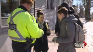 Police hand out reflective armbands