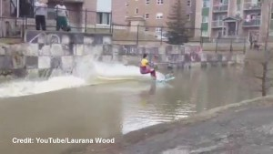 Bishop's University student water skis through flood waters on campus