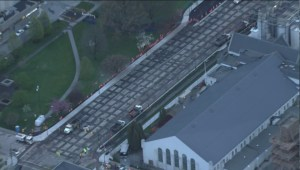 Raw: Birds-eye view of Burrard Bridge paving